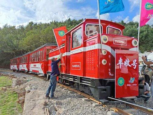 Sightseeing train in diesel loc